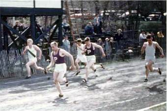 Pickford track team members race in 1954
